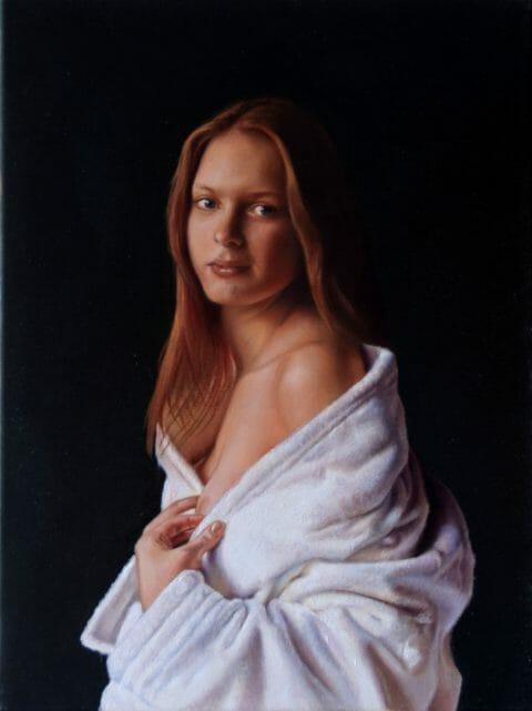 Young woman in bathrobe